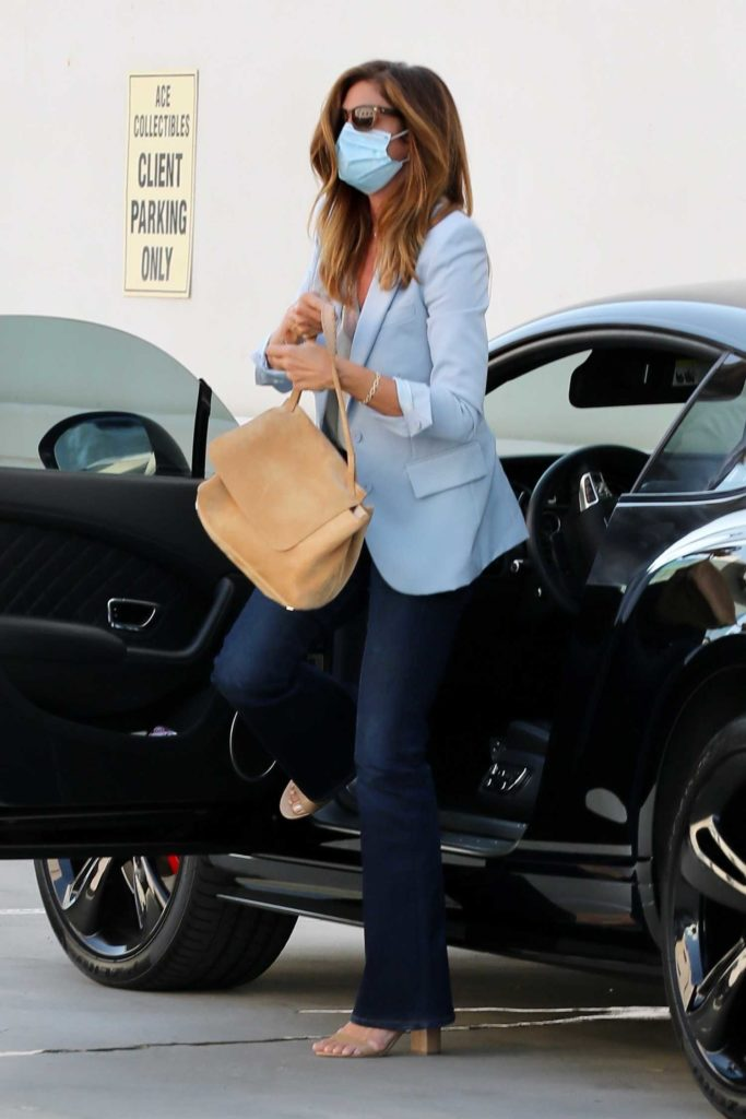 Cindy Crawford in a Light Blue Blazer