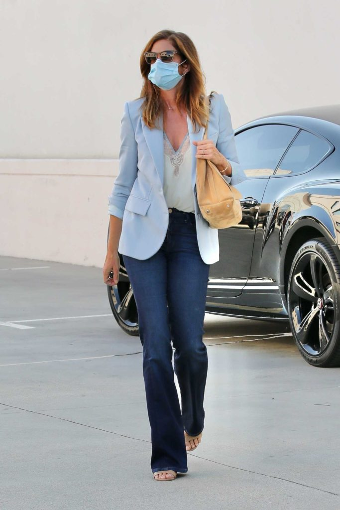 Cindy Crawford in a Light Blue Blazer