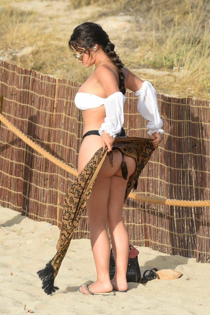 Demi Rose in a Black and White Bikini