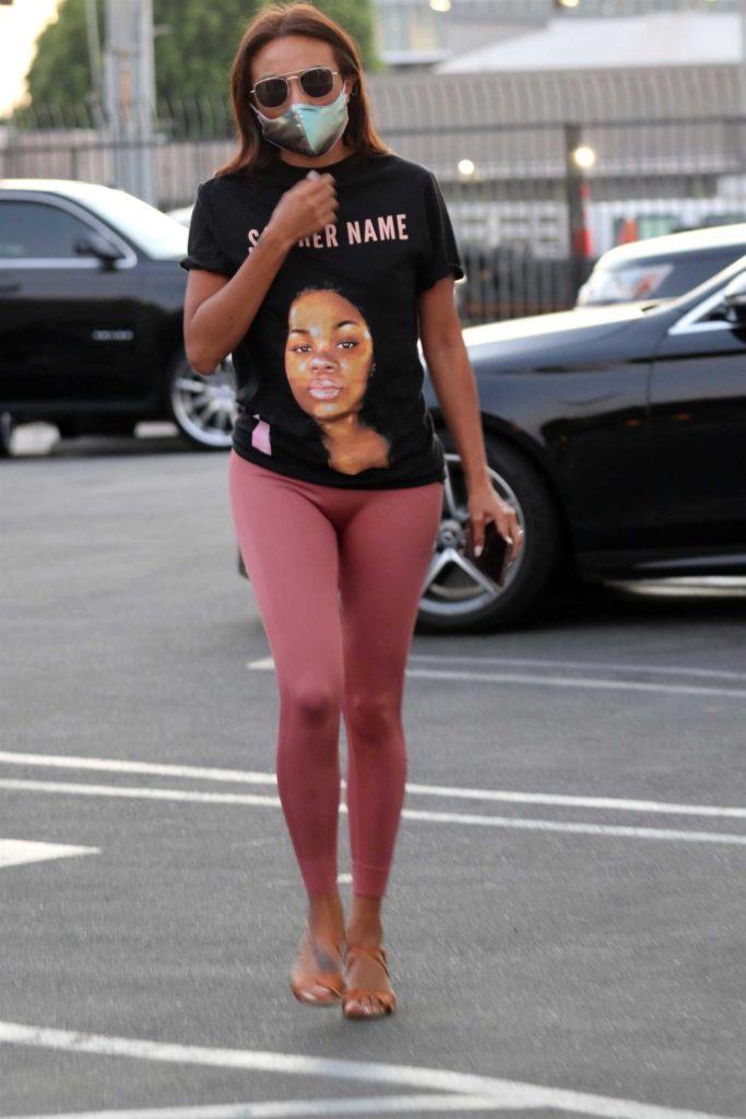 Jeannie Mai in a Pink Leggings