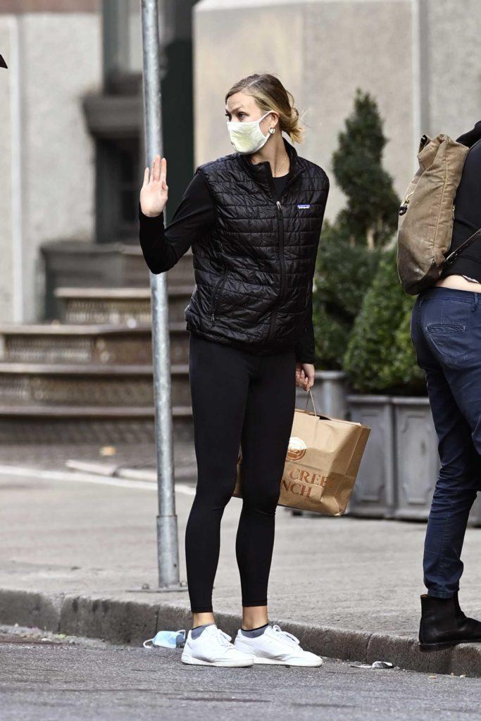 Karlie Kloss in a Black Jacket