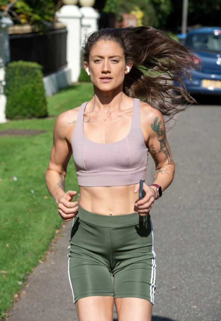 Katie Waissel in a Green Spandex Shorts