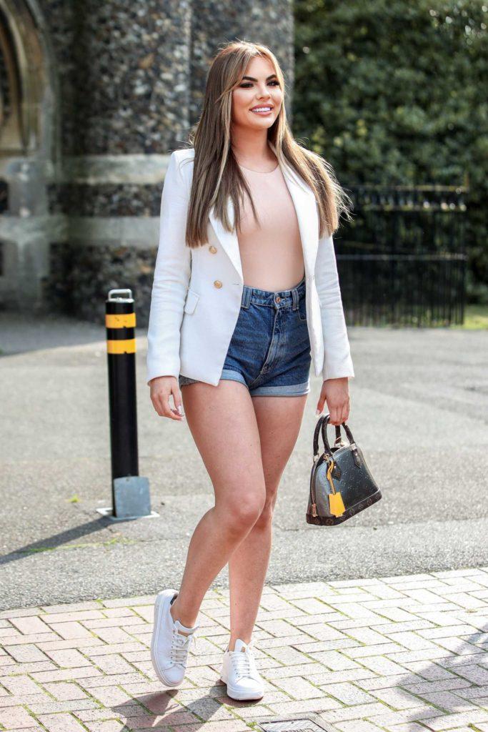 Kelsey Stratford in a White Blazer
