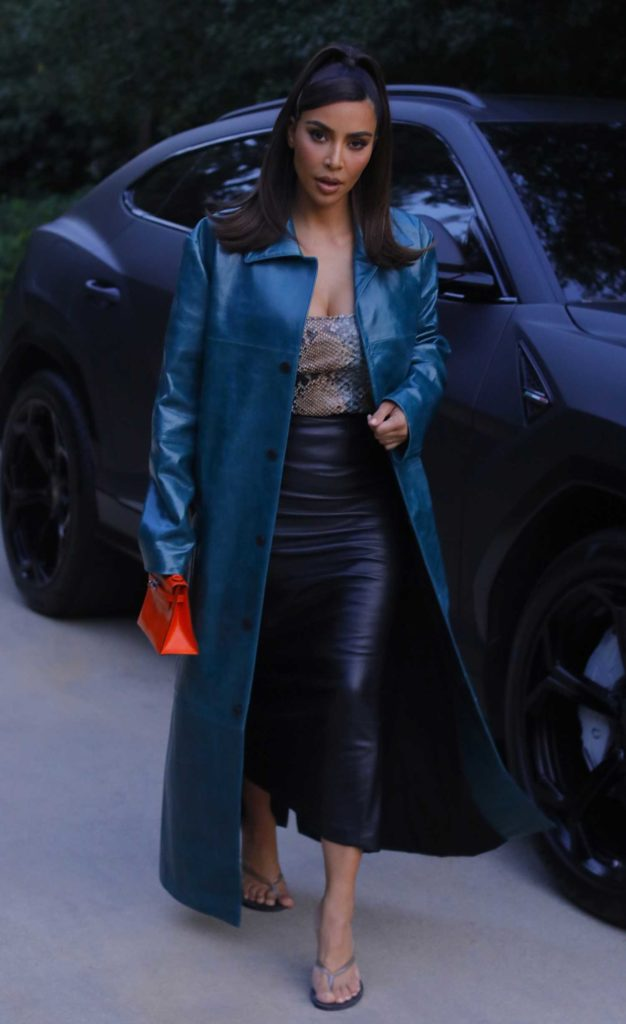 Kim Kardashian in a Blue Leather Trench Coat
