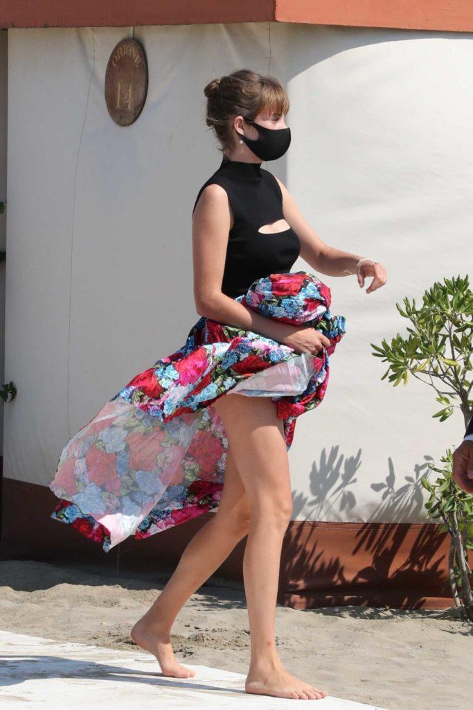 Maya Hawke in a Black Protective Mask