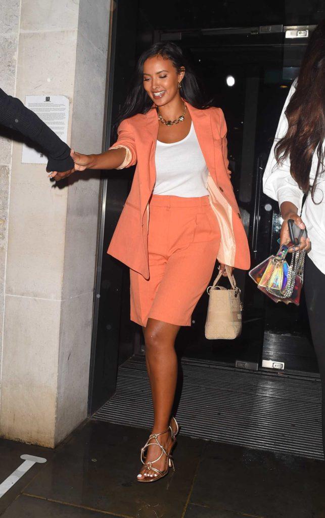 Maya Jama in an Orange Suit