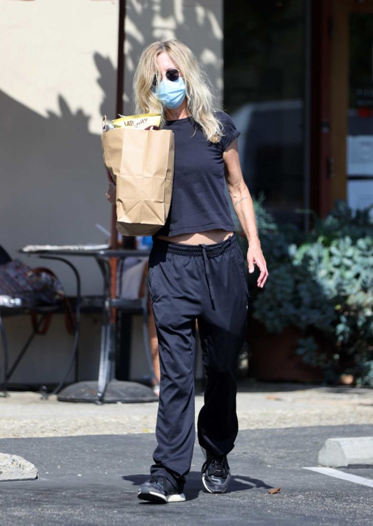 Meg Ryan in a Protective Mask
