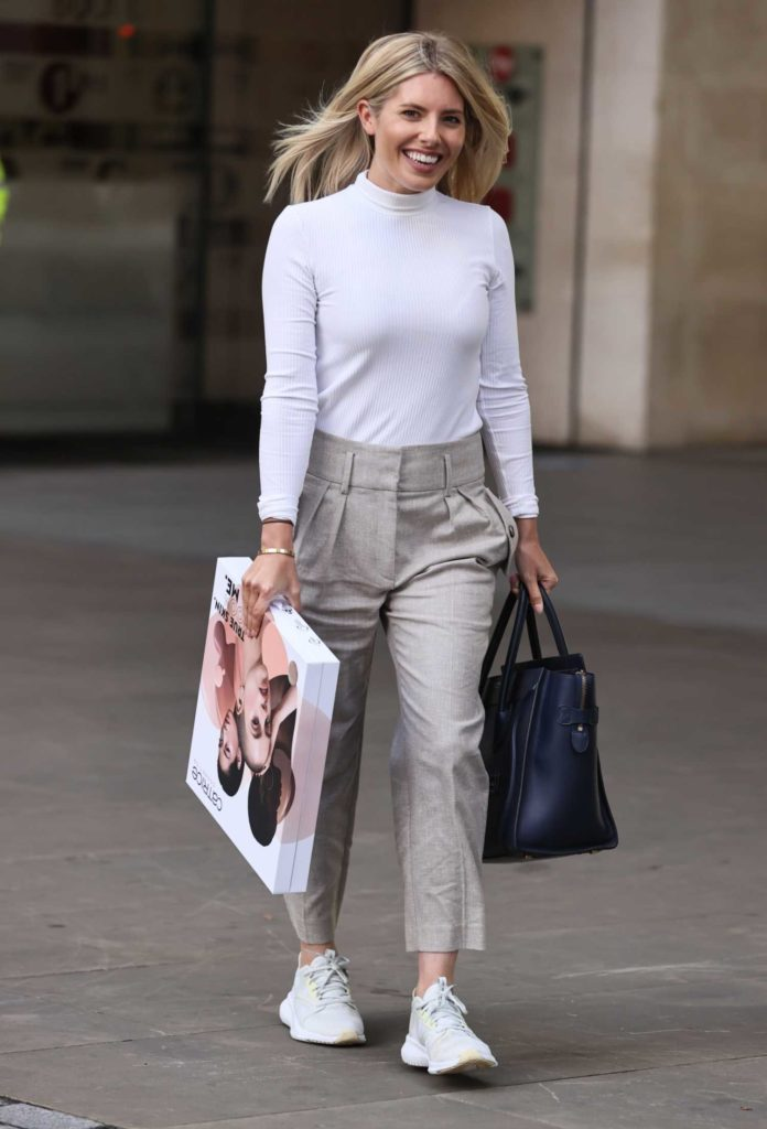 Mollie King in a White Turtleneck