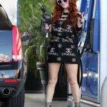 Phoebe Price in a Black Chanel Dress Pumping Gas in Los Angeles