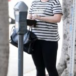 Rebel Wilson in a Striped Tee Visits a Skin Care Spa in Beverly Hills
