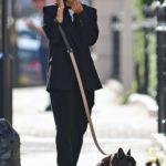 Shanina Shaik in a Black Blazer Walks Her French Bulldog in London