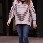 Anna Chlumsky in a Striped Sweater on the Set of Inventing Anna in Downtown Manhattan