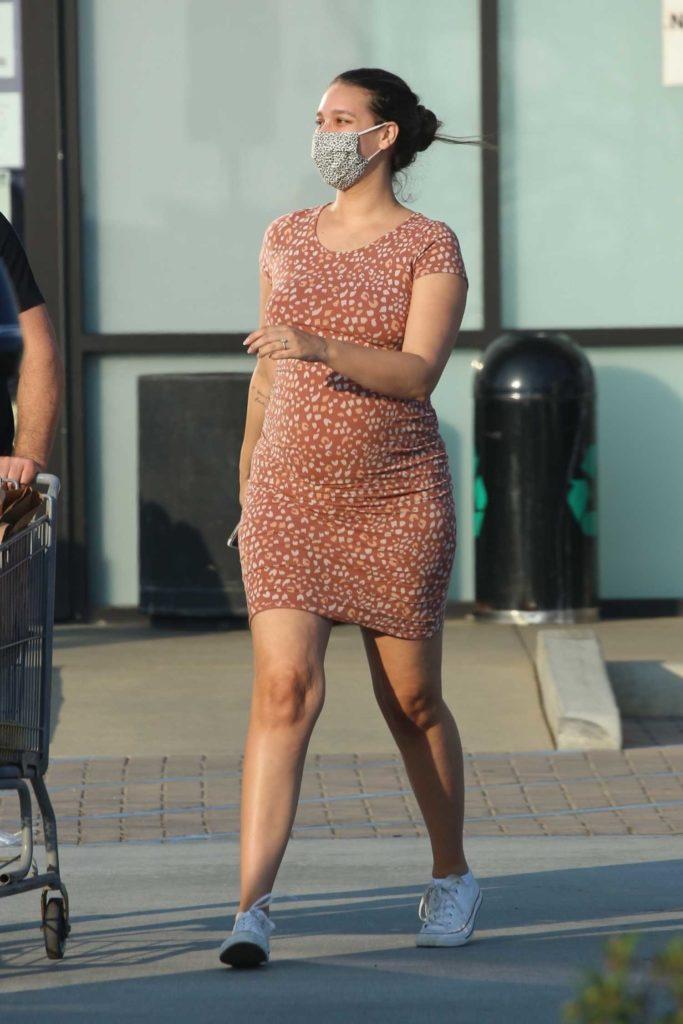 April Love Geary in a Tan Dress