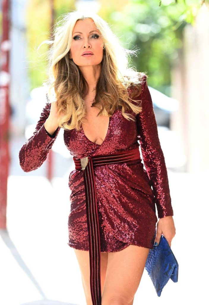 Caprice Bourret in a Leggy Sequin Dress