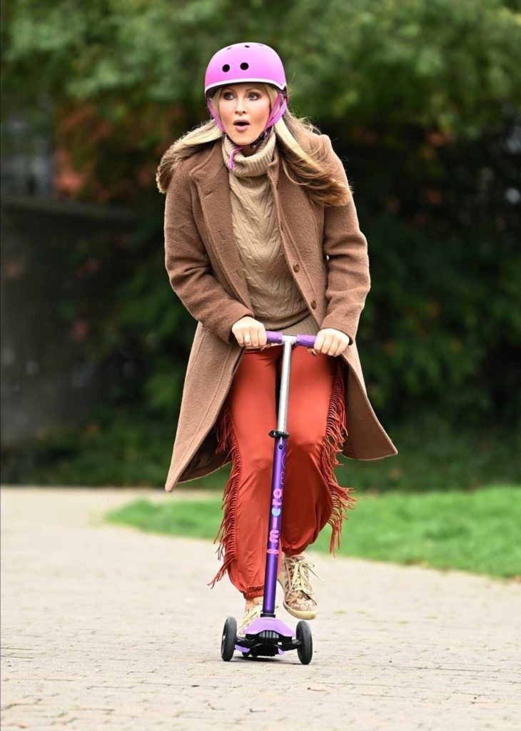 in a Red Pants Gets Around Town on Her Scooter Out in London 10/22/2020