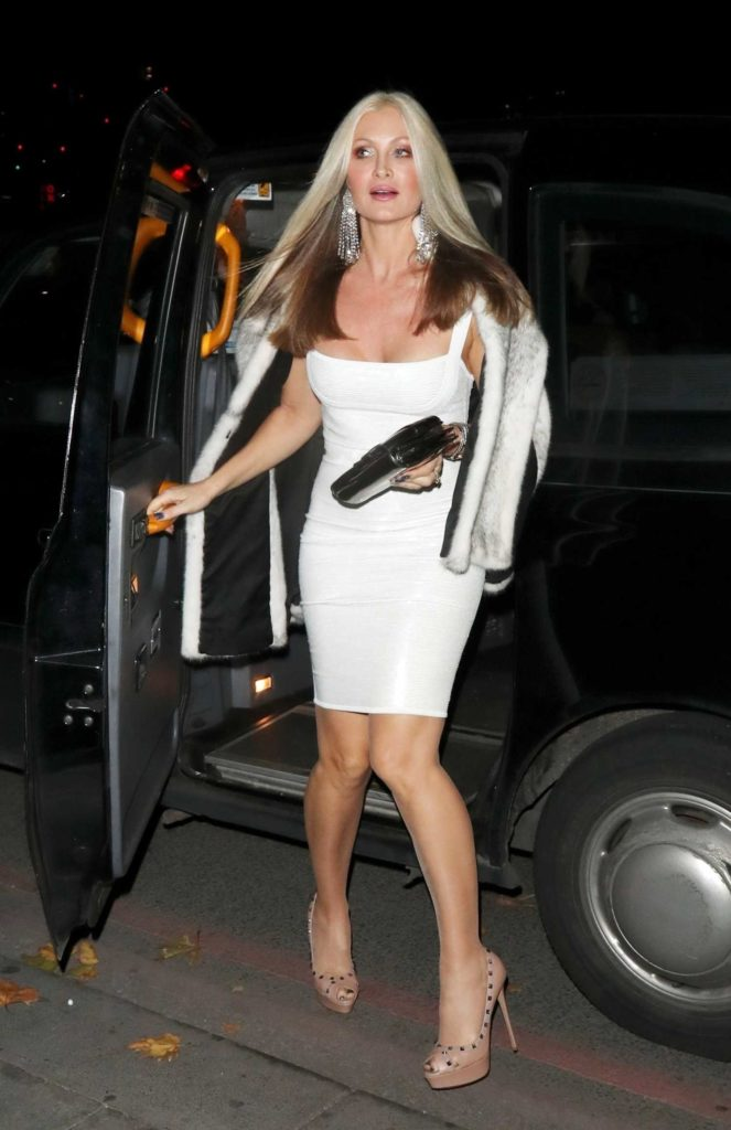 Caprice Bourret in a White Dress
