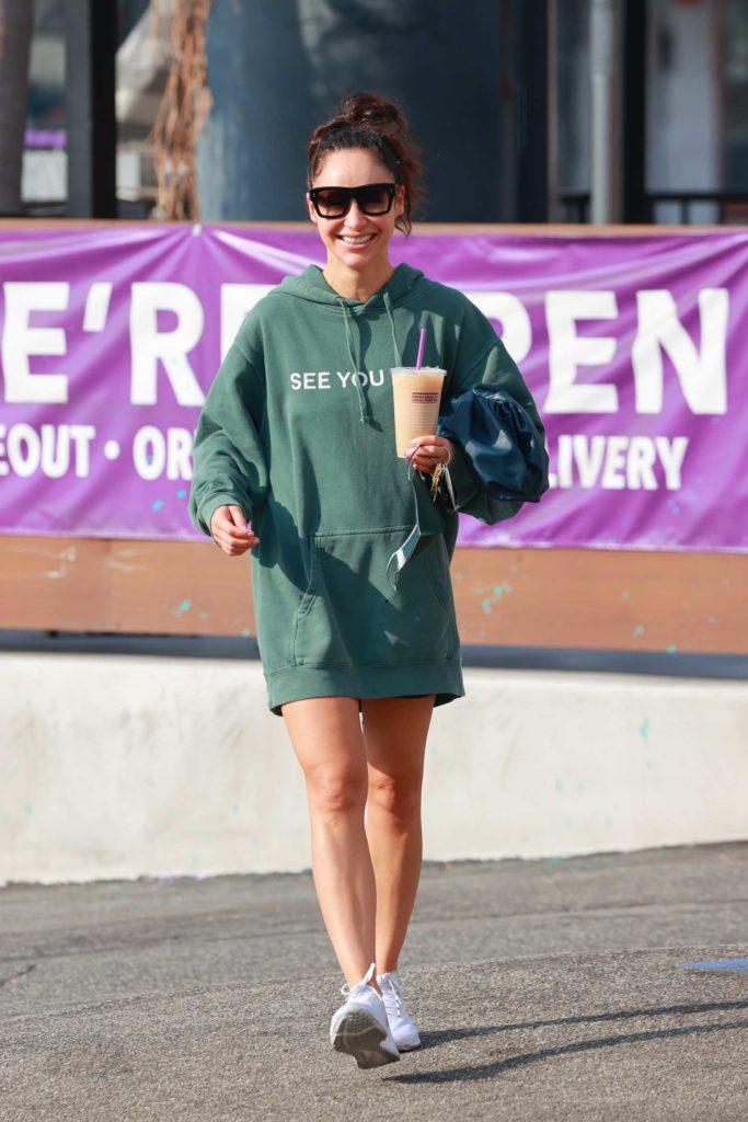 Cara Santana in a Green Oversized Hoodie