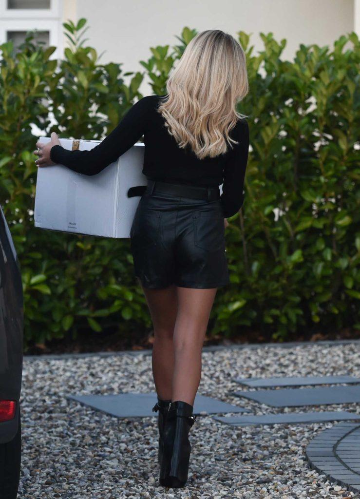 Ella Rae Wise in a Black Mini Skirt