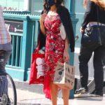Famke Janssen in a Red Dress Walks in the West Village in New York