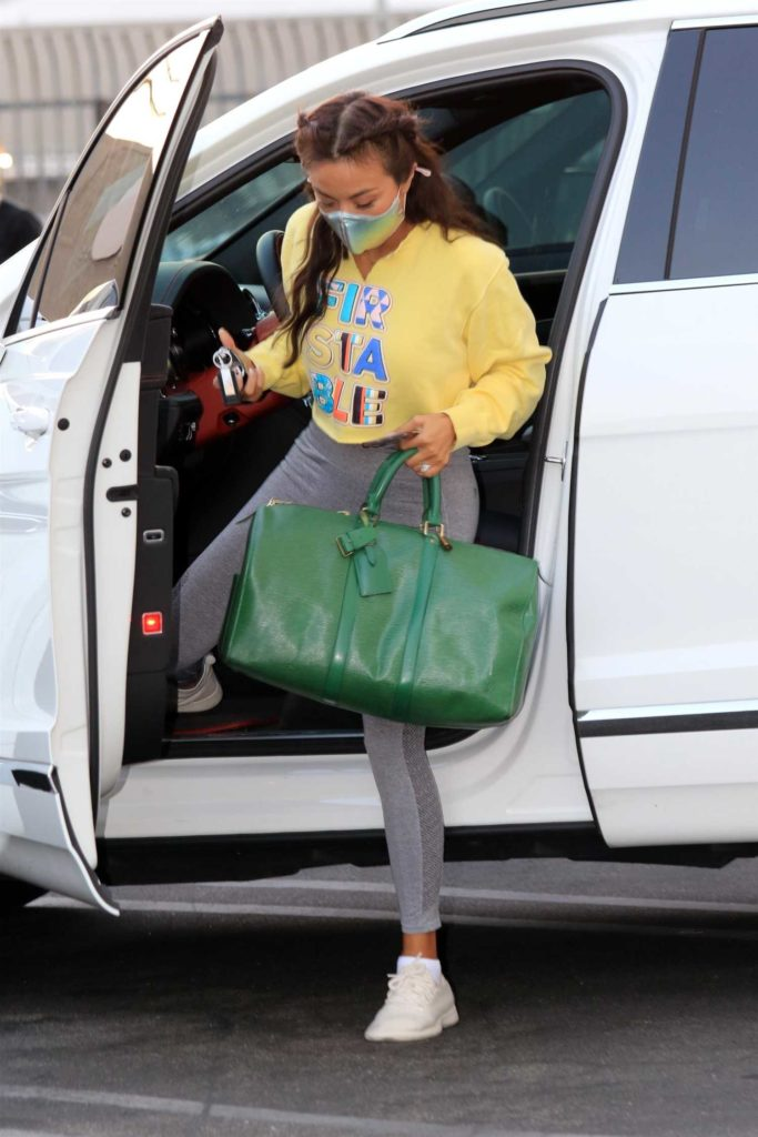Jeannie Mai in a Grey Leggings