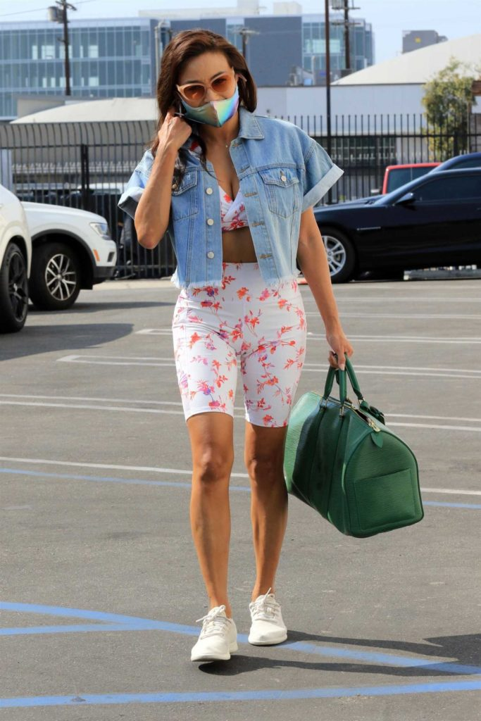 Jeannie Mai in a White Floral Workout Ensemble