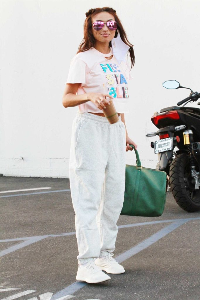 Jeannie Mai in a White Sneakers