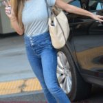 Joanna Krupa in a Grey Tee Flashes the Peace Sign while Out Picking up Packages in West Hollywood