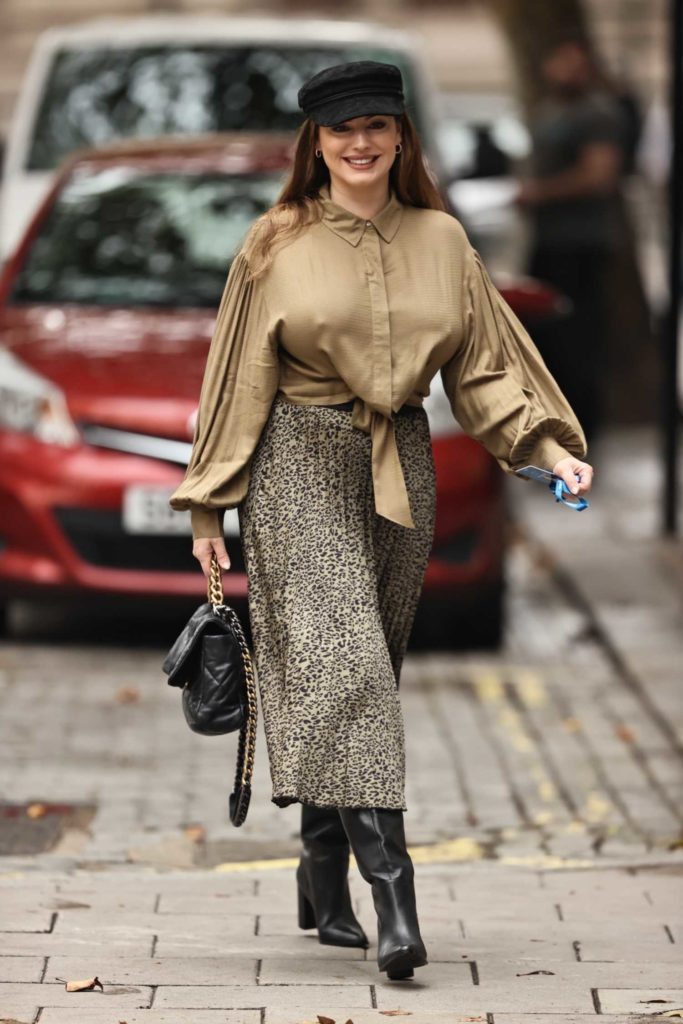 Kelly Brook in a Beige Satin Blouse