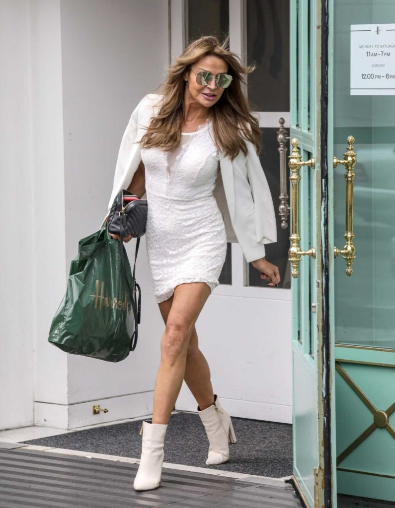 Lizzie Cundy in a White Blazer