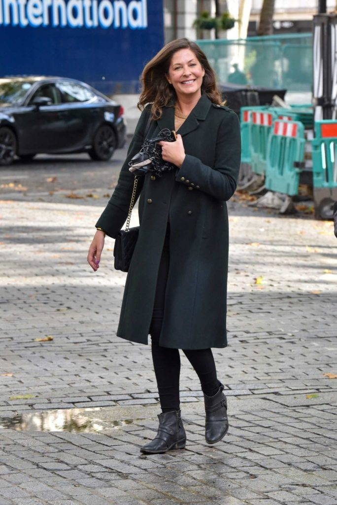 Lucy Horobin in a Black Coat