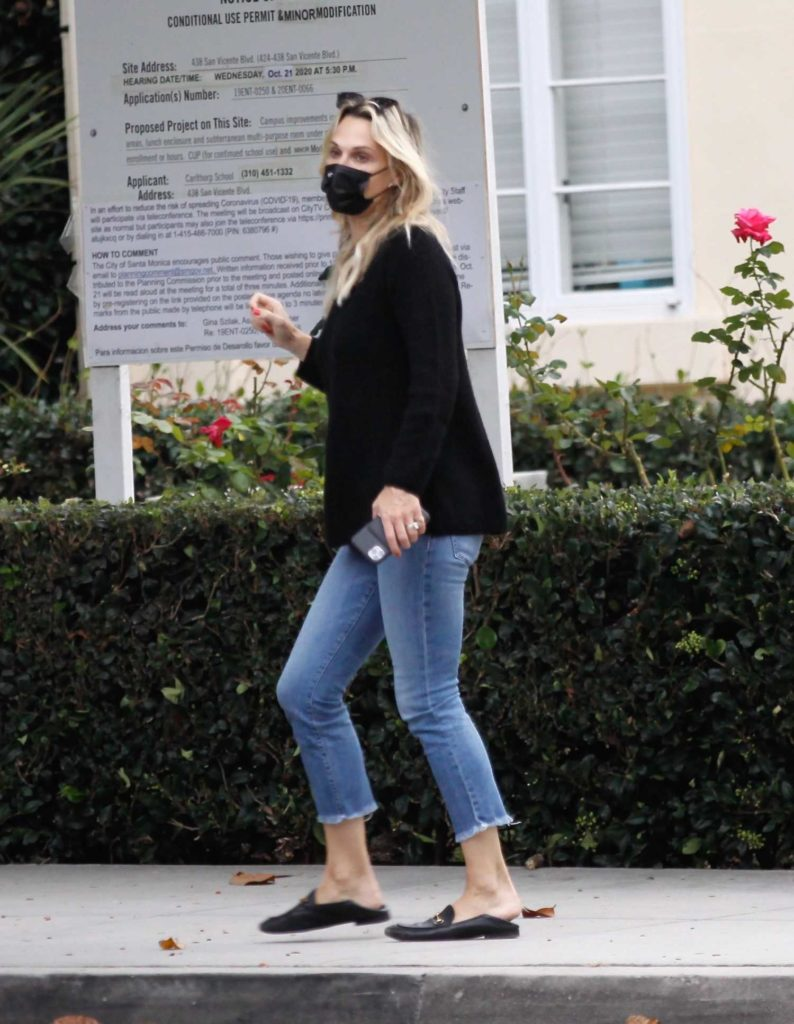 Molly Sims in a Black Protective Mask