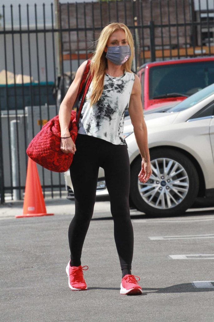 Monica Aldama in a Red Sneakers