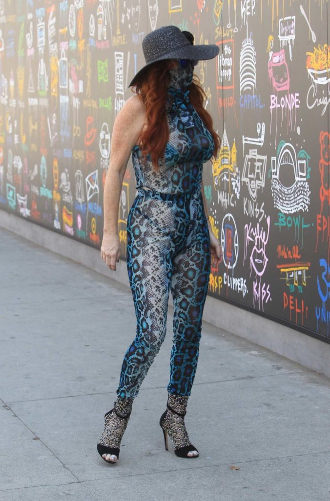 Phoebe Price in a Blue Snakeskin Patterned Jumpsuit