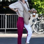 Scout Willis in a Beige Tee Carries Her Dog in a Crossbody Baby Sling in Los Angeles