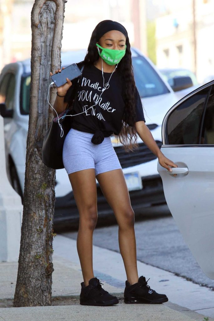 Skai Jackson in a Green Protective Mask