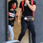 Skai Jackson in a Red Protective Mask Attends the DWTS Studio in Los Angeles