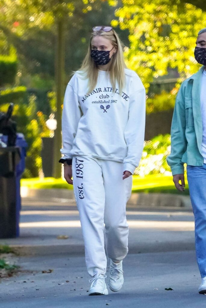 Sophie Turner in a White Sweatsuit