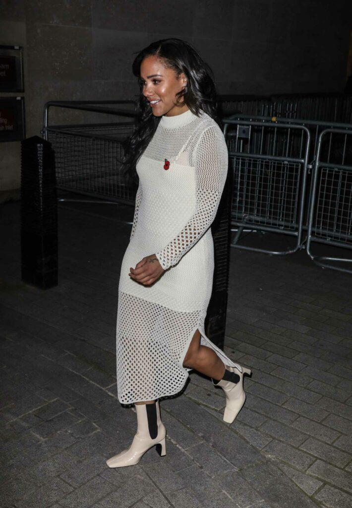 Alex Scott in a White Knit Dress