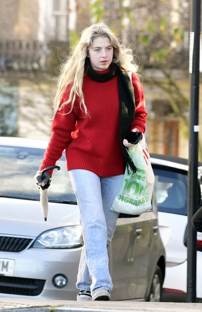Anais Gallagher in a Red Sweater
