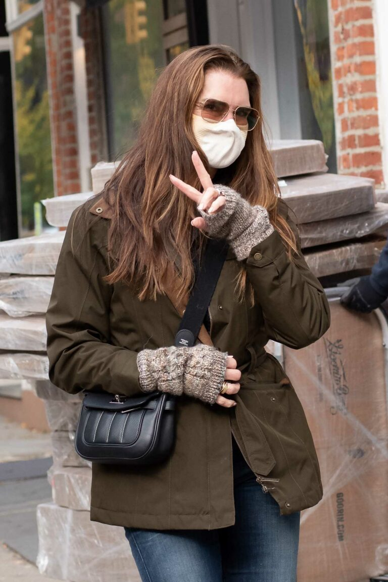 Brooke Shields in a Protective Mask Flashes a Peace Sign