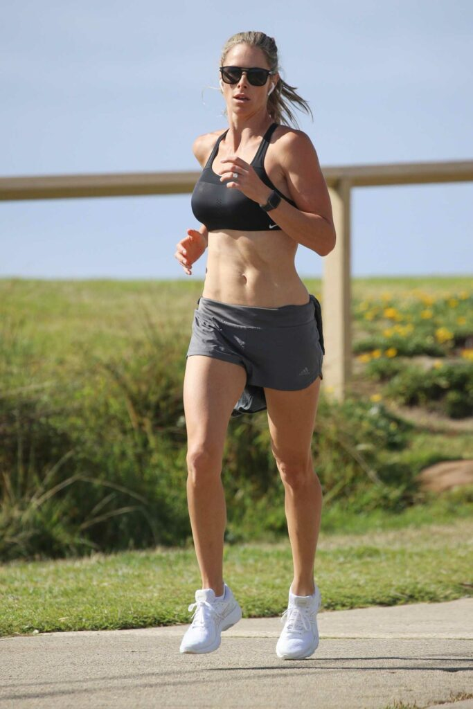Candice Warner in a Black Sports Bra