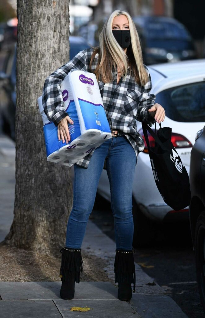 Caprice Bourret in a Grey Plaid Shirt
