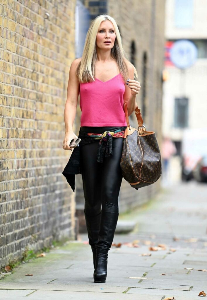 Caprice Bourret in a Pink Top