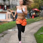 Caprice Bourret in a White Sports Bra Goes for a Jog Out in London