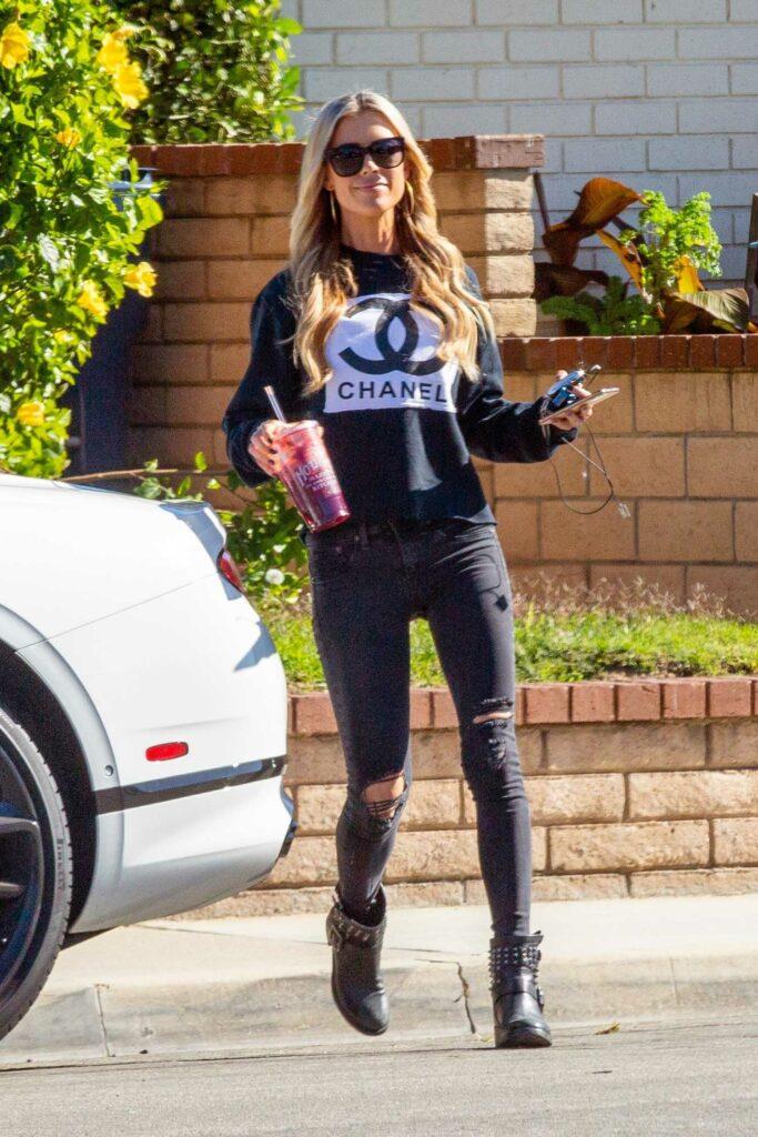Christina Anstead in a Black Chanel Sweatshirt