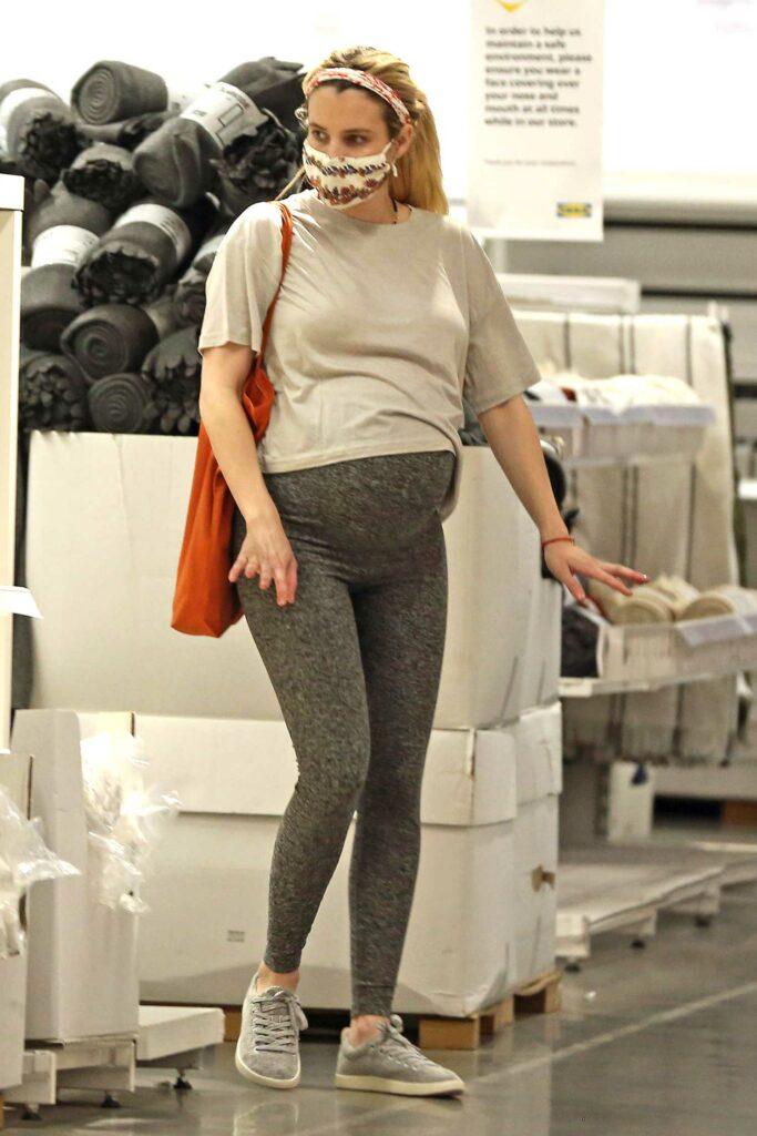 Emma Roberts in a Grey Leggings