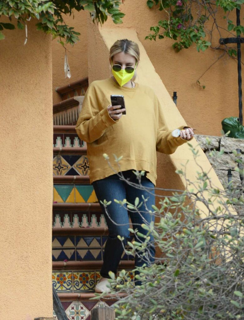Emma Roberts in a Yellow Sweatshirt