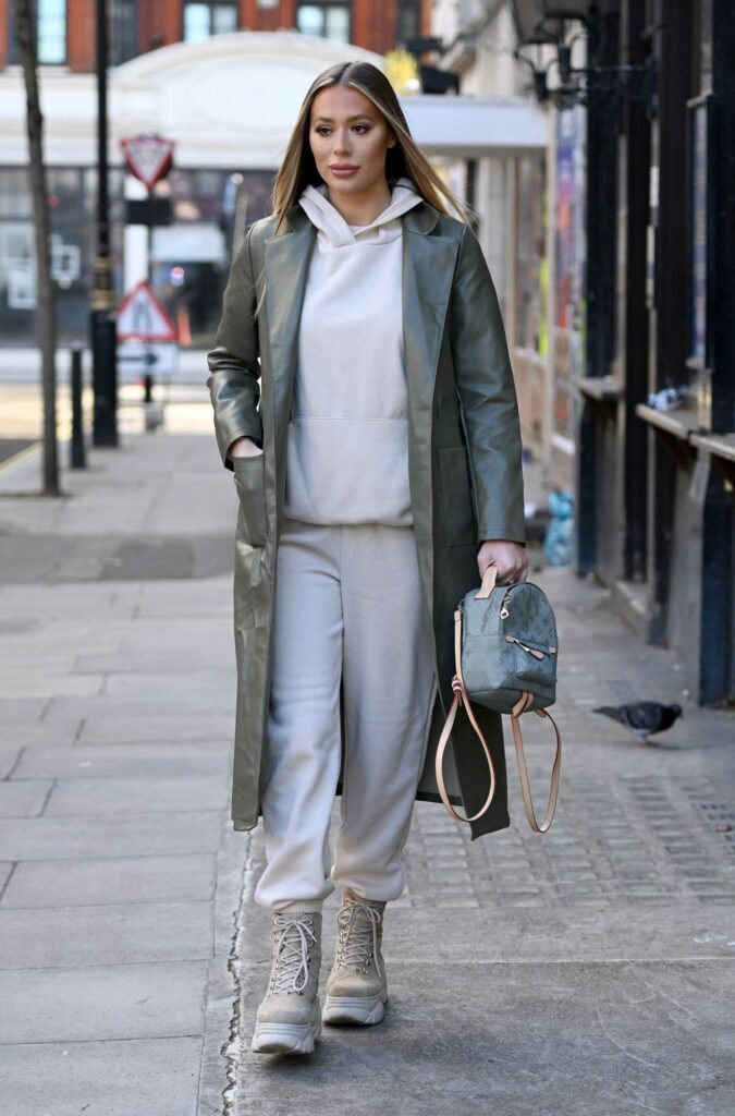 Frankie Sims in an Olive Leather Trench Coat