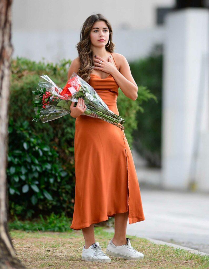 Hannah Ann Sluss in an Orange Dress