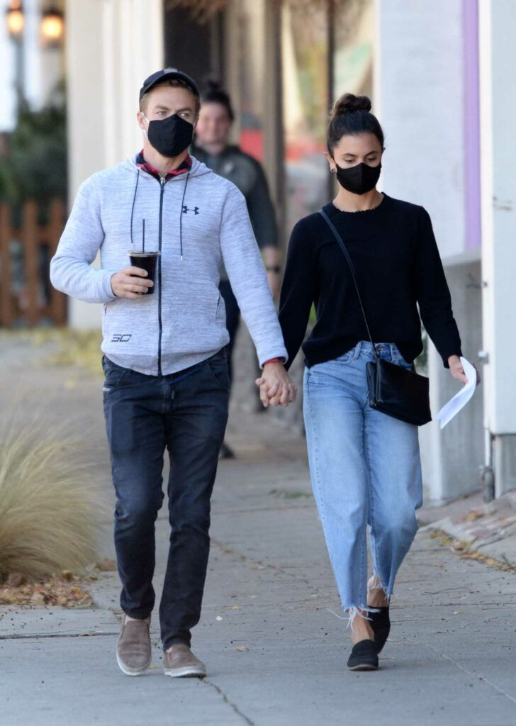 Hayley Erbert in a Black Protective Mask